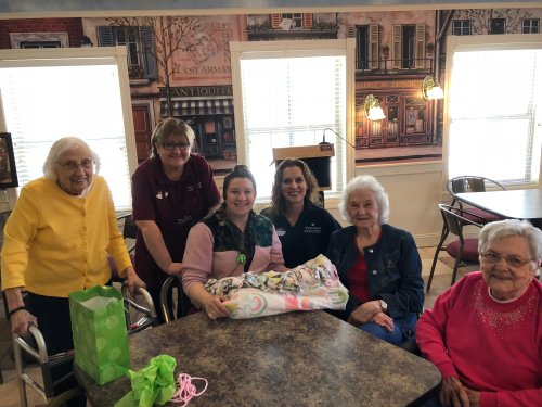 Impromptu gifting of blanket to Megan. Blanket made by Cold Hands Warm Heart Group.