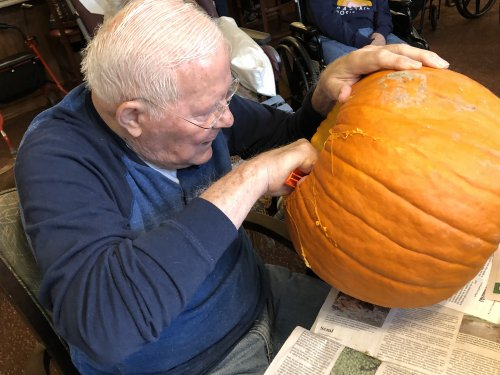 Carving pumpkins on Halloween! Thank you Bob for doing the dirty work.