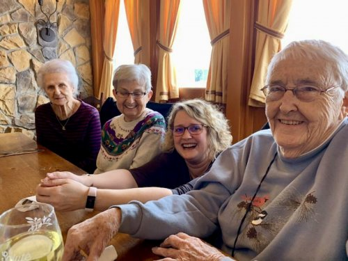 Residents Helen, Sally and Pat having a wonderful time at Olive Garden along with Life Enrichment Coordinator Chris