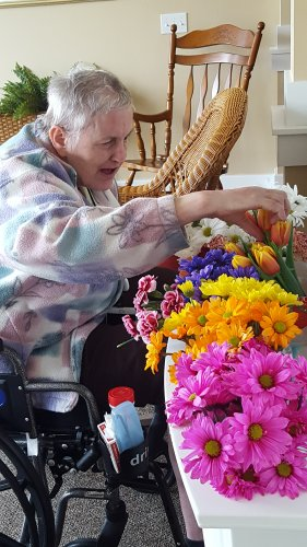 Lori enjoys picking out a Bouquet of fresh flowers for her room.