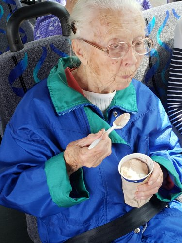 Dorothy and other residents go on scenic van ride while eating ice cream.