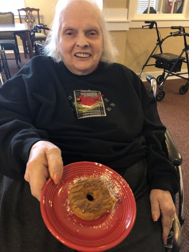 Carol shows the homemade donut she decorated.