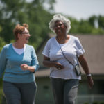 Two active seniors taking a walk; how to prevent falls