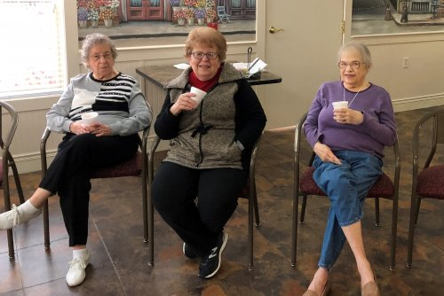 The ladies are enjoying a nice hot cup of hot chocolate on this snowy afternoon.