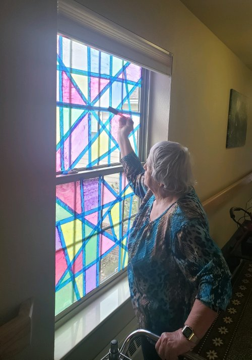 Dolly had so much fun painting our windows to look like stain glass windows.