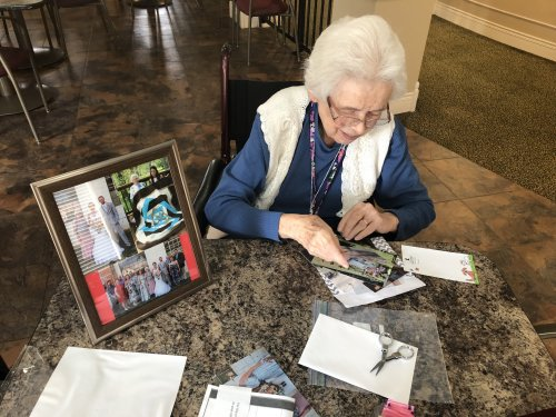 Linda is sparking her creativity with a family collage she can share with family and friends.