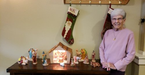 Kelly with her handmade Nativity Scene...she brought it when she moved with us and now allows us to display it every year with our community decorations.