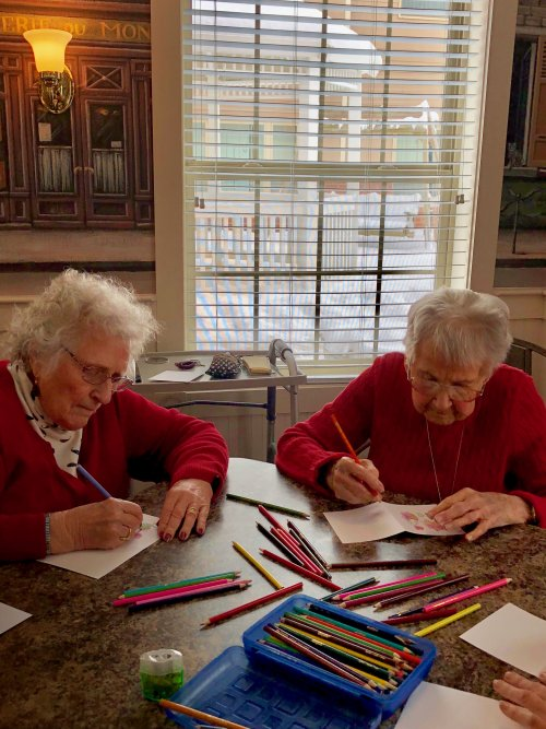Jennie and Pat are enjoying making Valentine cards.