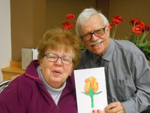 Jean and our art instructor, Bob showing her rose that she painted.