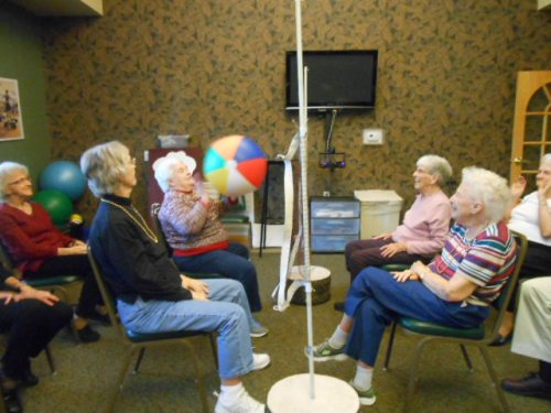 Residents are wondering who the ball will be hit to next during chair volleyball.