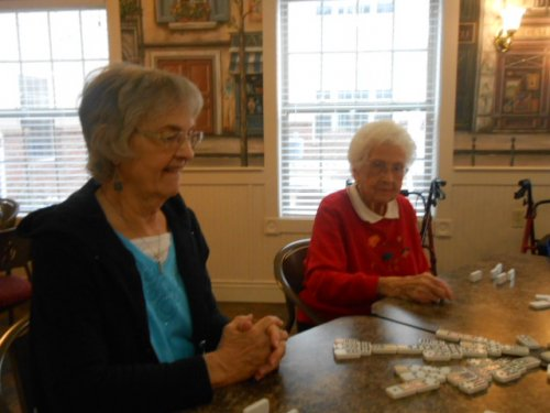Barb and Janice playing 'chicken foot' dominoes.
