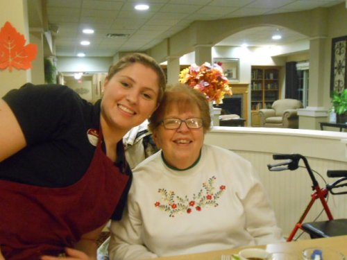 Resident Jean and Employee Taylor taking a moment for a picture!
