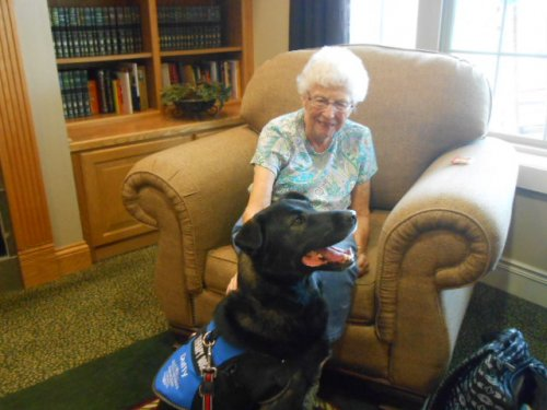 Irene with Duffy, a therapy dog visiting the residents.