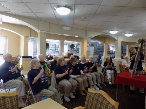 Primrose Bell Choir performing for the other residents!