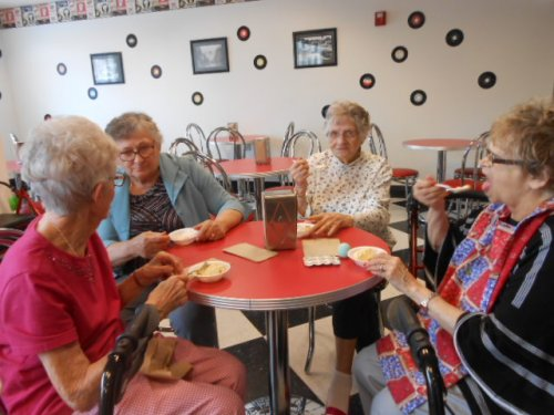 Residents are enjoying ice cream after an afternoon of activities!