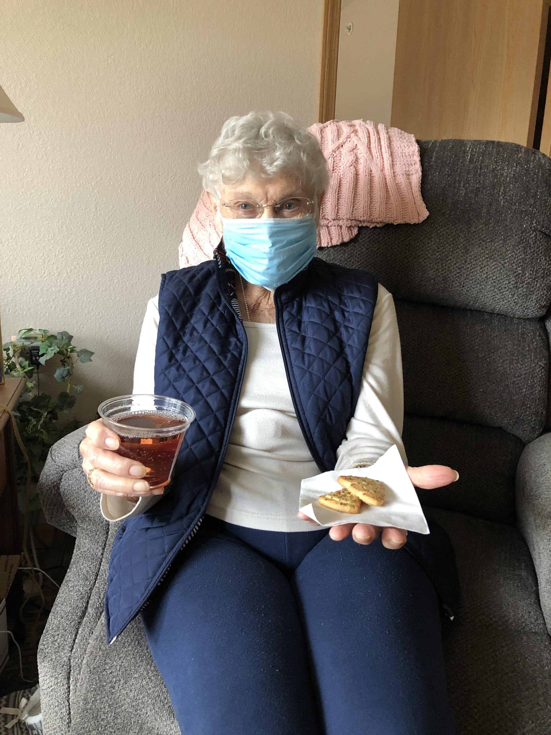 Peggy enjoying her wine and holiday cookies!