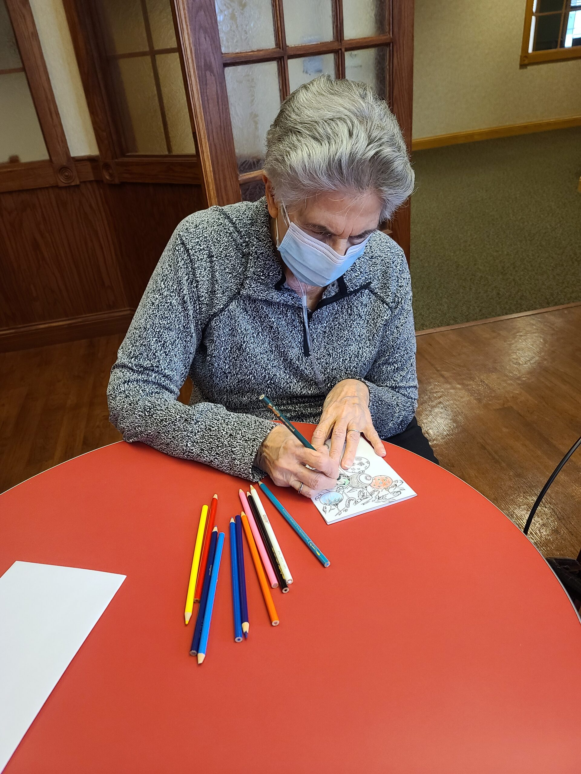 Josephine is coloring cards to pass out to her family!