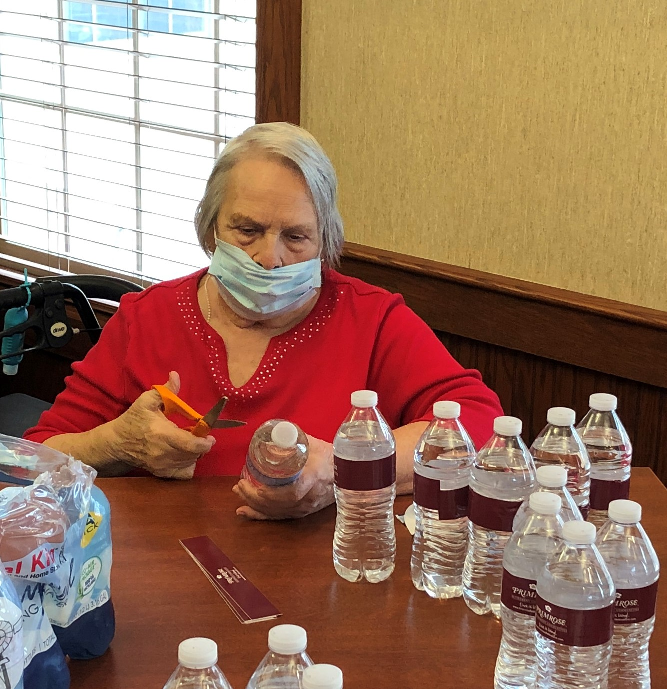 Dolly hard at work wrapping water bottles with the Primrose logo to pass out on RAOK day!